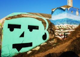 Art Rock Cafe: Old WWII Beach Bunkers Glow With Graffiti Graphics